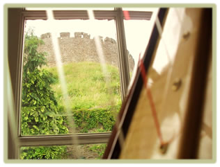 Totnes Castle, viewed through a harp in our harp lessons studio in Devon, South west England.