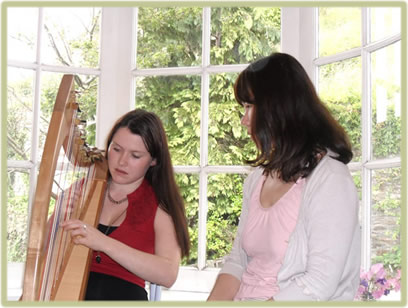 Misuzu Matsumoto providing harp lessons to students of all ages